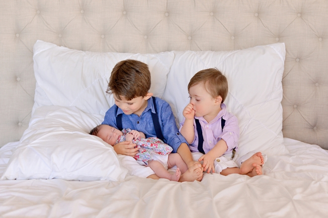 Natural fun studio newborn session of a family of 5 with a brand new baby girl