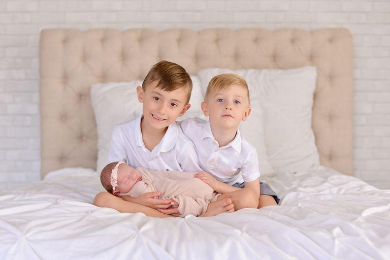 Baby girl newborn session in studio. Natural fun family session in studio. Family of 5 photo session in Tampa, FL.