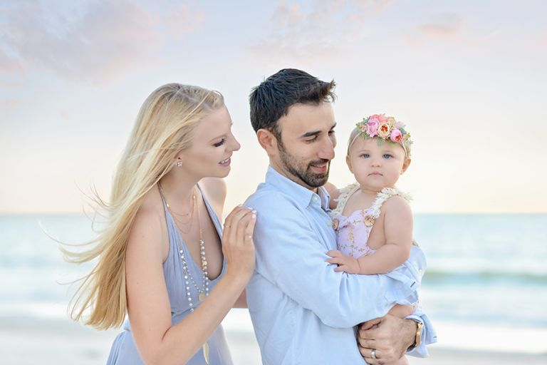 Nine month old baby girl session at the beach. Pastel photo session at Redington Shores. Family photo session at Clearwater Beach.