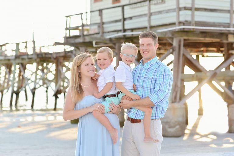 Beach maternity family session fun natural boys blue pier