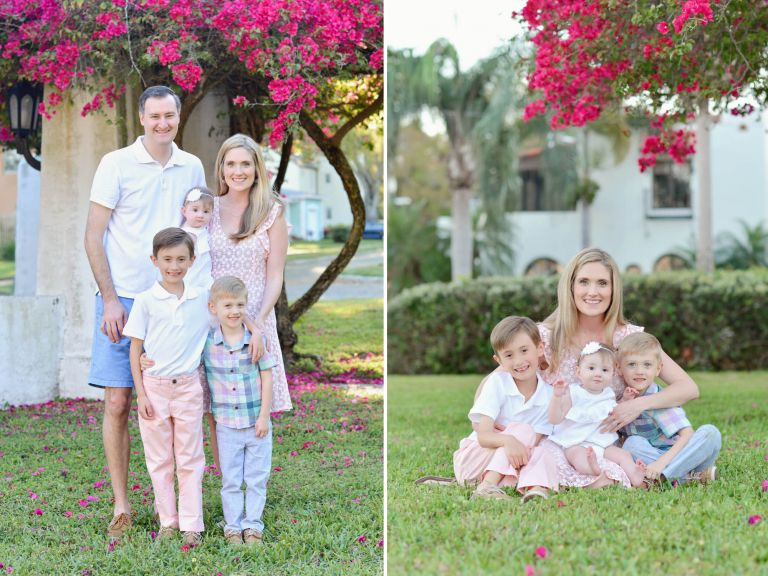 A family of five with 2 boys and a baby girl being photographed in a park with pink flowers and a white pergola in St Petersburg Florida.
